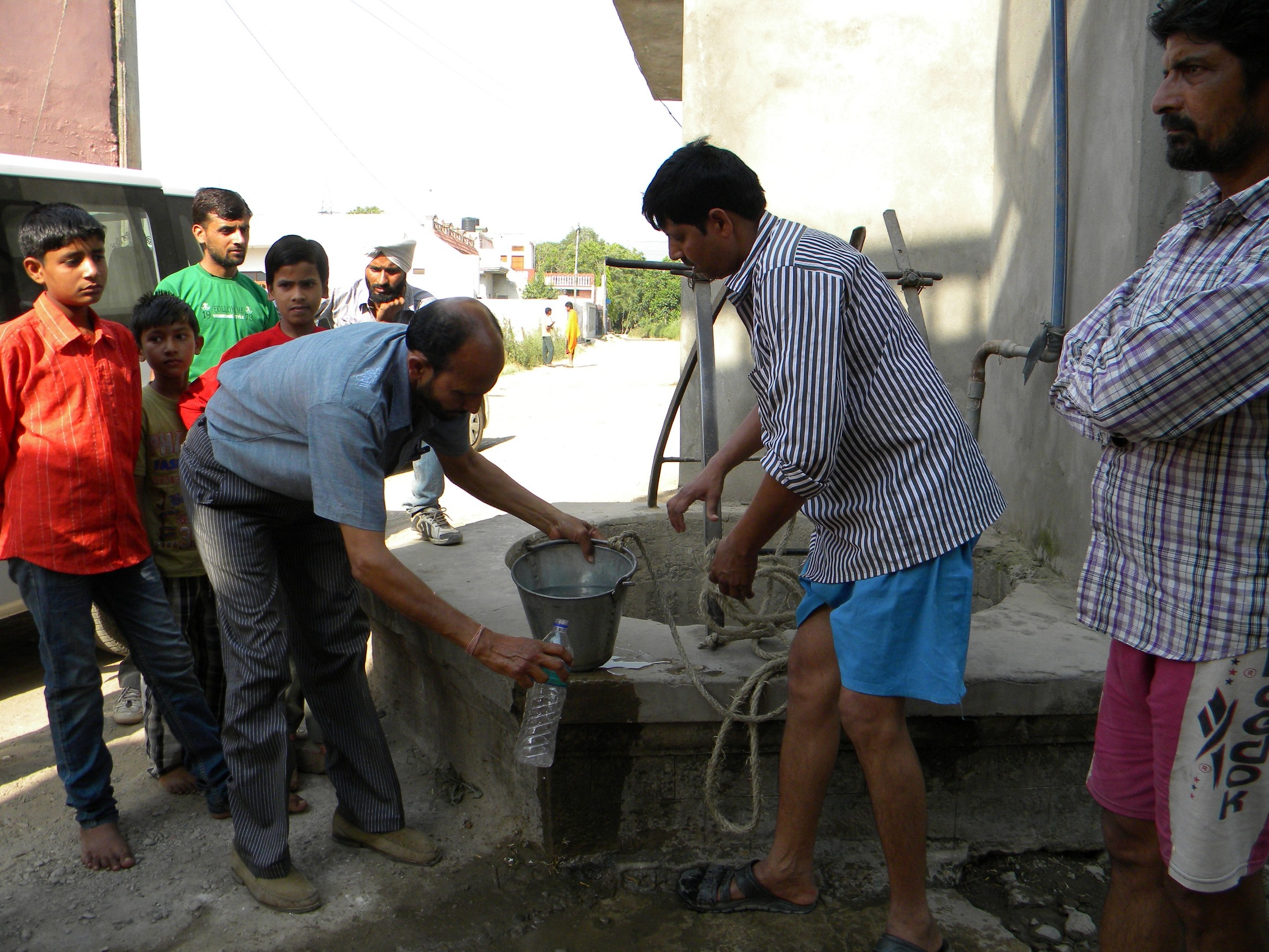 Balkrishna Shamra taking water sample at Kishanpura