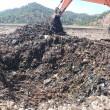 JCB burying waste
